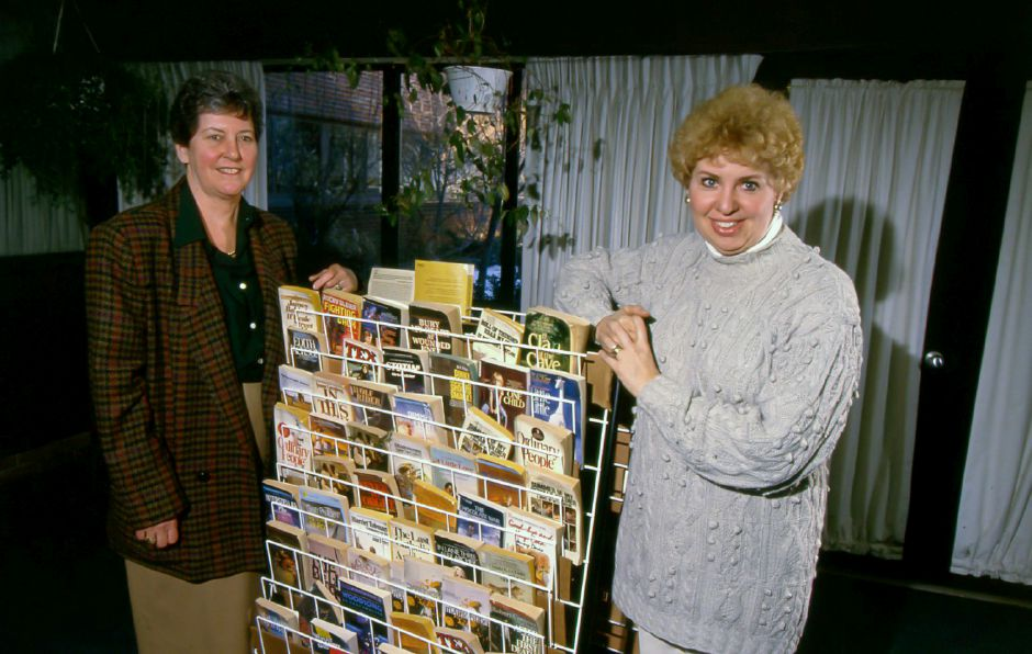 RJ file photo -Library Media Specialist Carol Davidson, left, and teacher Sandra Klimkoski flank a book display in the Platt High School Library Feb. 25, 1994.