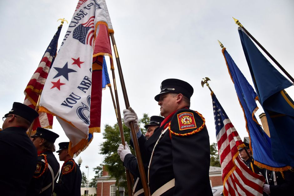 Members of the town fire department, police department, color guard and veterans and fraternal organizations