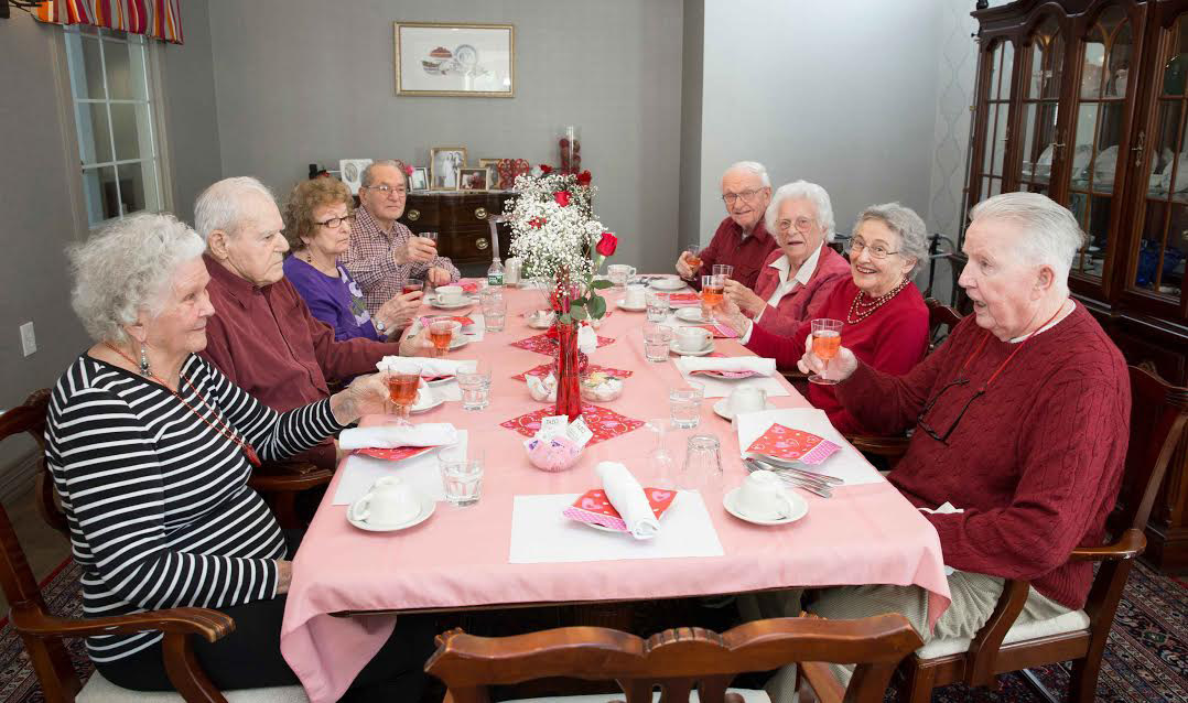 Mulberry Gardens resident ,Tom Scanlon, presents a toast to his wife and the other three couples who celebrated Valentine's Day.