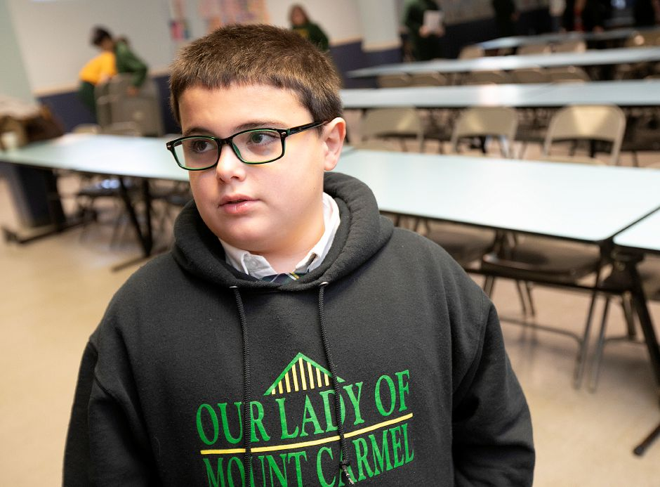 Fourth-grade student Maddox Dow, 9, talks after a Veteran