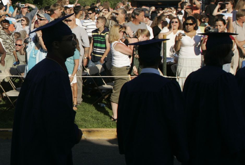 Family and friends greet Platt graduates processing to the stage during the start of graduation ceremonies at Platt High School June 18, 2007. (dave zajac photo)