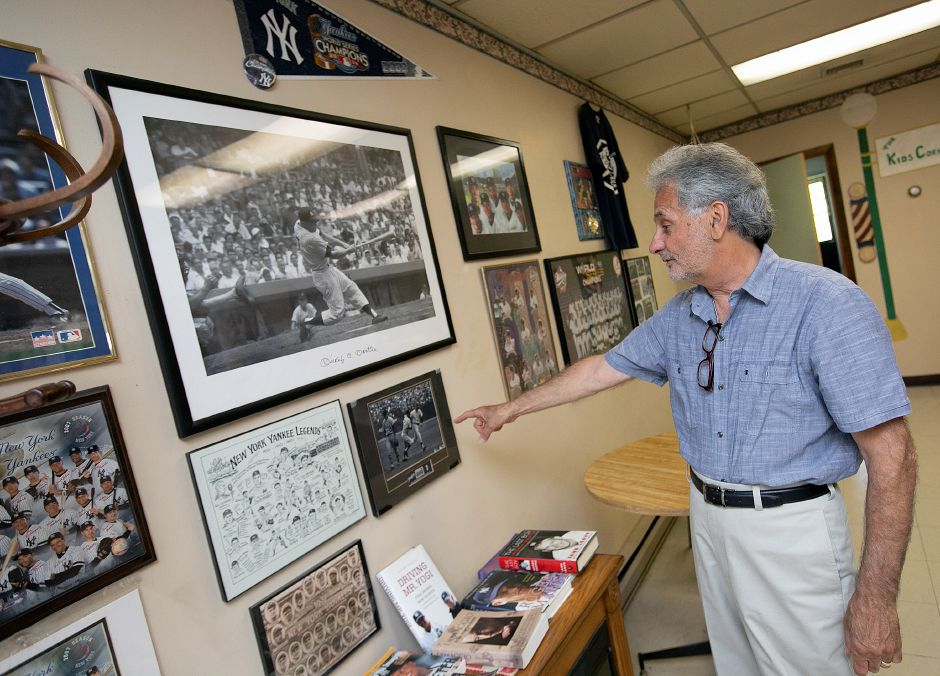 "Barber Prisco ""Pic"" DeLuca talks about his favorite piece of Yankee memorabilia, a photo of Mickey Mantle's walk-off homerun in game 3 of the 1964 World Series. DeLuca is retiring  after  46 years.Dave Zajac, Record-Journal"