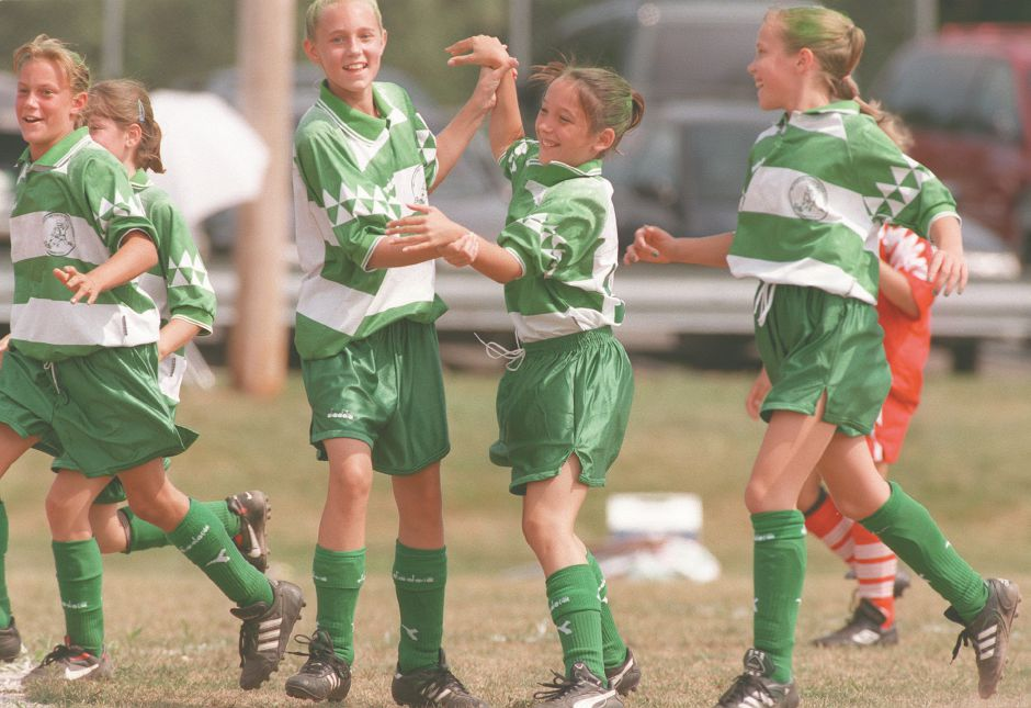 RJ file photo -Alicia Rohner (left of center) high-fives teammate Linsey Alexander after Alexander scored a goal for the Wallingford Twisters against the Somers Fire Balls during The Wallingford Invitational Soccer Tournament Aug. 15, 1998.