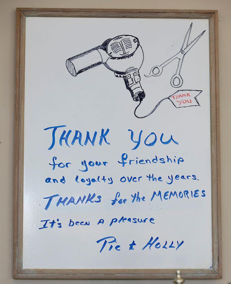 "A ""Thank You"" to customers of barber Prisco ""Pic"" DeLuca and stylist Holly Charamut at Haircraft Hair Salon, 1259 E. Main St. Meriden, Fri., June 28, 2019. DeLuca is retiring and closing the business after cutting hair for 46 years.   Dave Zajac, Record-Journal"