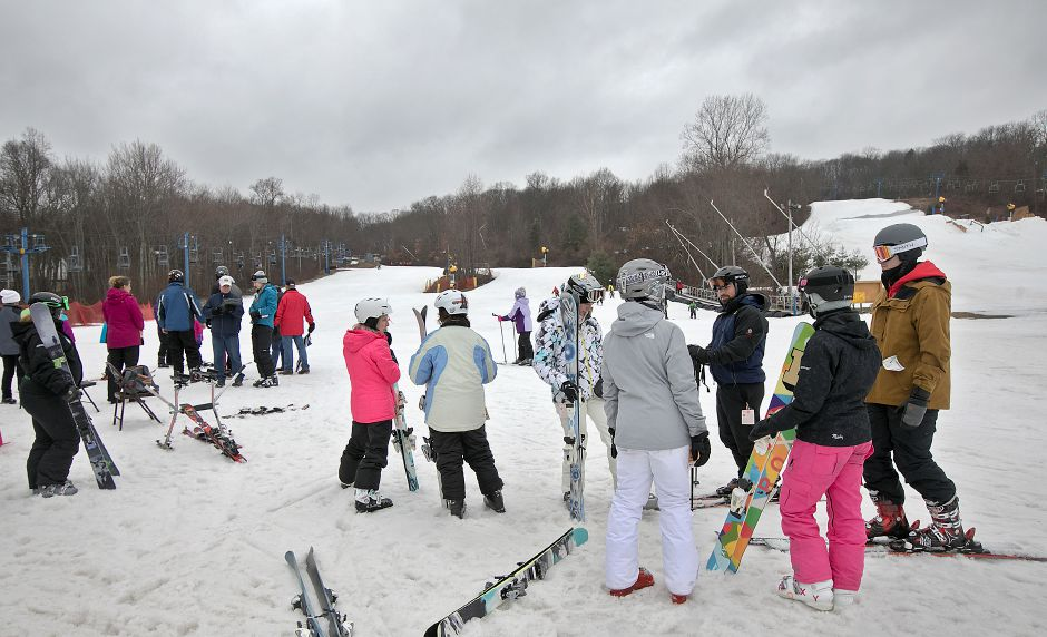 Ski nstructors prepare to pair up with children during the Connecticut Children