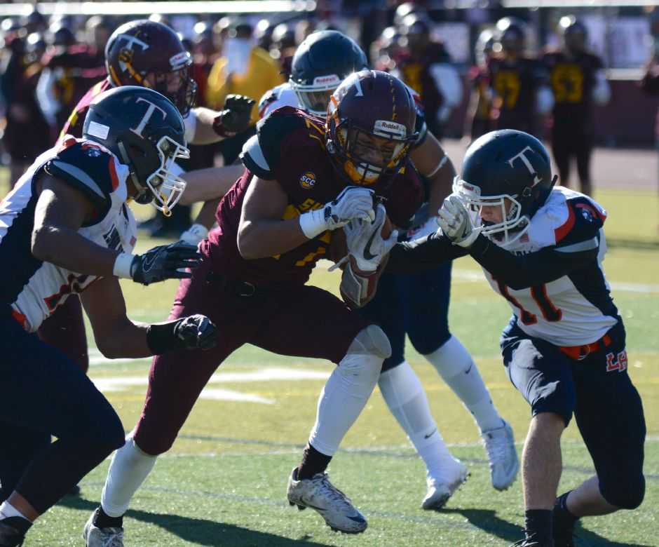 Jordan Davis, of Sheehan, is tackled in the team's annual Thanksgiving Day football game against Lyman Hall on Thursday, Nov. 23, 2017. The Titans defeated the Trojans, 49-20. | Bryan Lipiner, Record-Journal