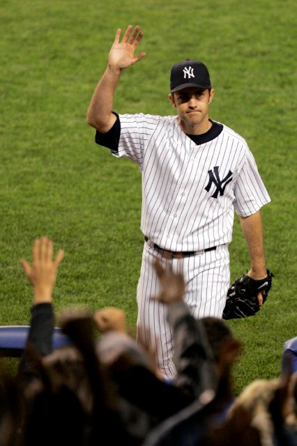 FILE - In this May 10, 2006, file photo, New York Yankees pitcher Mike Mussina waves to the crowd while leaving the game during the seventh inning against the Boston Red Sox at New York