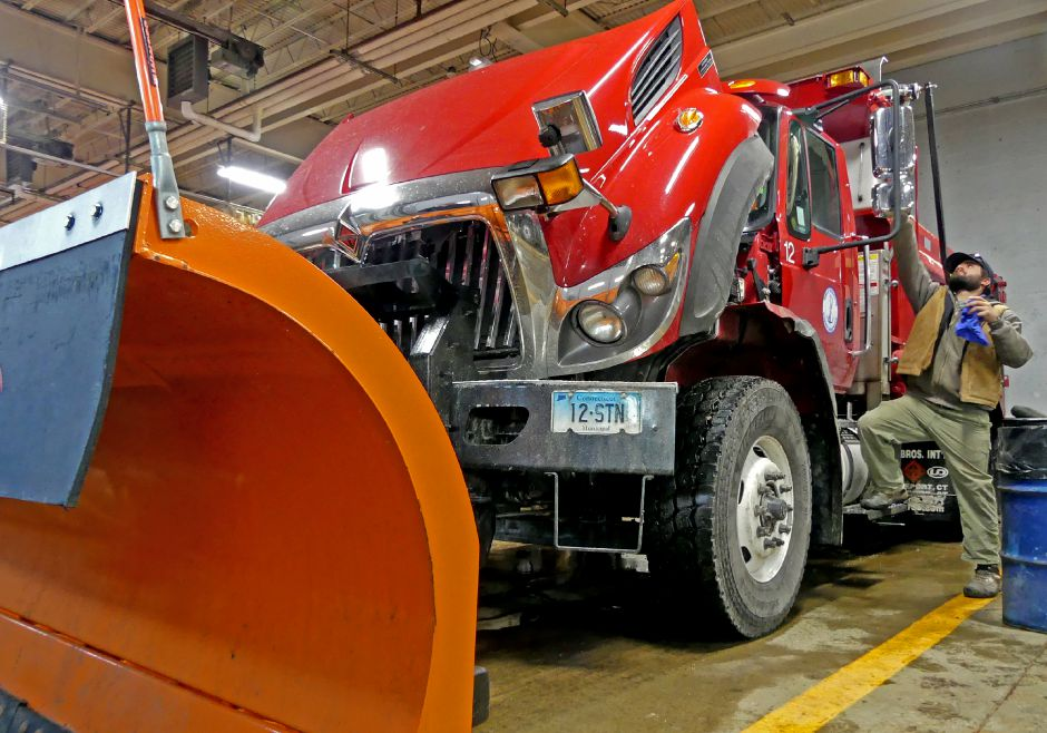 Stonington Public Works Steve Mcnair cleans windshields and mirrors on snow plows in the town garage. at the town facility. Town public work crews were kept busy on Wednesday, Jan. 3, 2017, preparing for the major snowstorm due to blanket the region on Thursday. Harold Hanka, The Westerly Sun