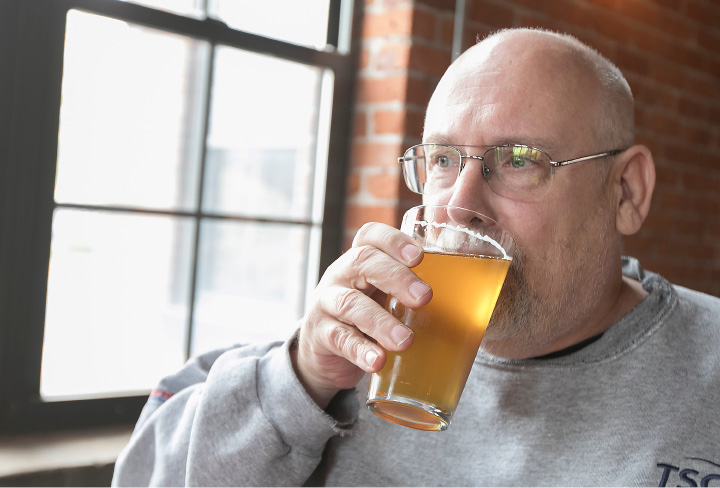 Carl Forster, of Southington, samples Antidote Kolsch, a German style hybrid ale/lager at Witchdoctor Brewing Company, a new business in Factory Square on Center Street in Southington, Wednesday, April 26, 2017.  | Dave Zajac, Record-Journal