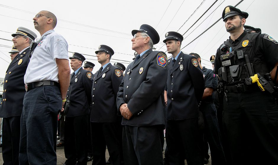 Southington firefighters and police stand together during the annual 9/11 remembrance ceremony at the 9/11 memorial site along the Farmington Canal Heritage Trail in Southington, Tuesday, Sept. 11, 2018. Dave Zajac, Record-Journal