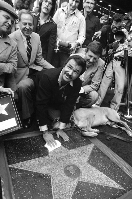 "FILE - In this March 15, 1978 file photo, actor Burt Reynolds polishes star that was unveiled in the Hollywood Walk of Fame in Los Angeles. Reynolds, who starred in films including ""Deliverance,"" ""Boogie Nights,"" and the ""Smokey and the Bandit"" films, died at age 82, according to his agent. (AP Photo/file)"