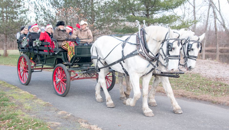 One of two horse-drawn carriages at the Holiday Celebration on the Linear Trail circles Lakeside Park on Sunday. The event was organized by the Linear Trail Advisory Committee, which helps maintain the trail.