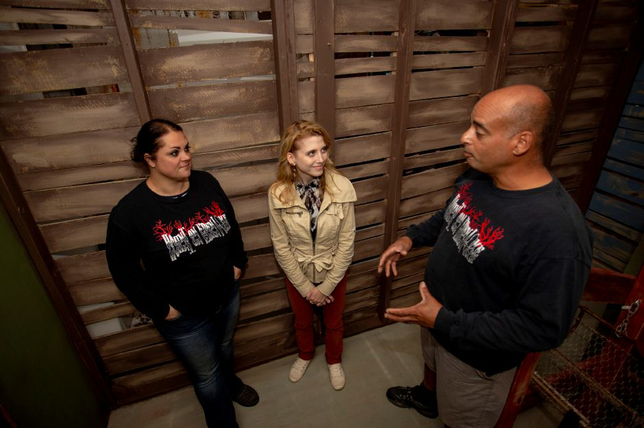 Record-Journal digital content producer Ashley Kus, center, talks with Haunt on Eden founders Susan and Jeff Donis.