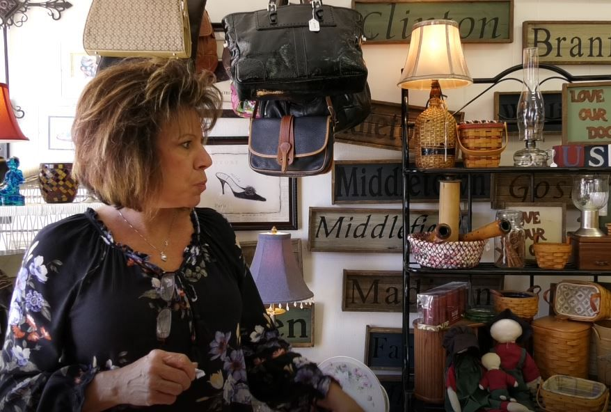 Owner Cindy Ruszczyk stands in her shop, Cindy