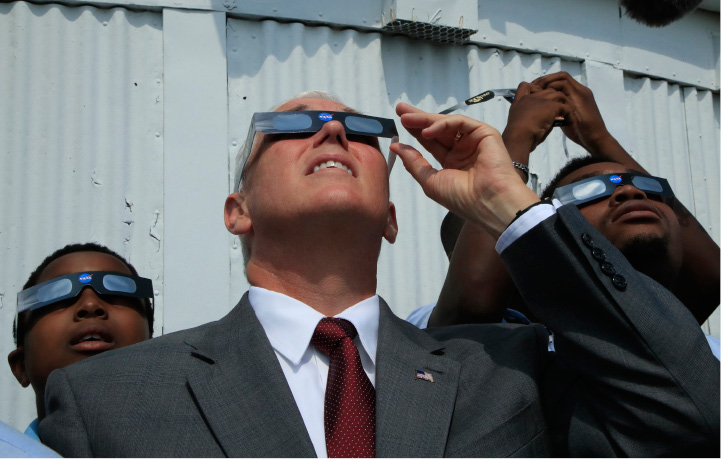 Vice President Mike Pence, with students from Cornerstone Schools, watches the solar eclipse, Monday, Aug. 21, 2017, at the U.S. Naval Observatory in Washington. (AP Photo/Manuel Balce Ceneta)