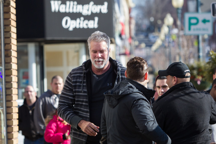 Pro wrestler Kevin Nash walks the sidewalk on Center Street for an autograph session Saturday at M & J Video Game and First Base Collectables in Wallingford Jan. 30, 2016 | Justin Weekes / For the Record-Journal