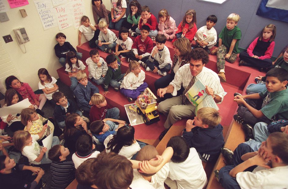 "RJ file photo -Author Edward Siebert Jr. of Meriden reads his book, ""The Candy Lottery"" that art teacher Anita Pelletier, to his right, illustrated, to a group of students at Yalesville School, Dec. 1998."