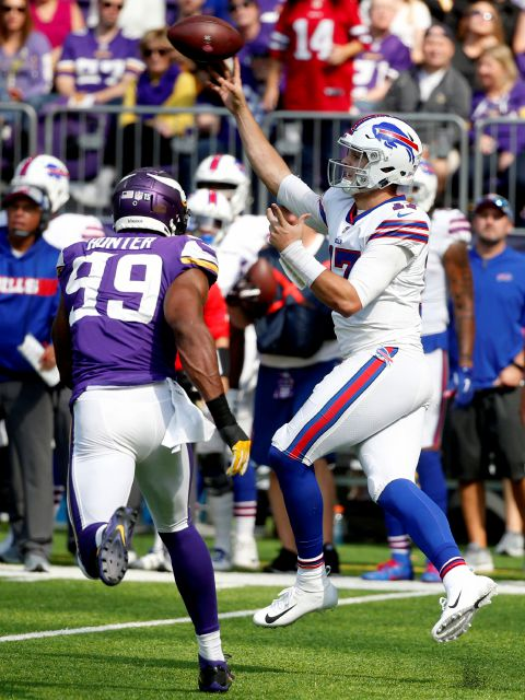 Buffalo Bills quarterback Josh Allen throws a pass over Minnesota Vikings defensive end Danielle Hunter (99) during the first half of an NFL football game, Sunday, Sept. 23, 2018, in Minneapolis. (AP Photo/Bruce Kluckhohn)