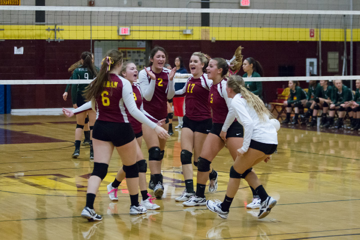 Sheehan's girls volleyball team celebrates after winning a long volley against Maloney at Sheehan High School in Wallingford on Wednesday. The Titans improved to 11-4 despite dropping the first game.| Photos by Justin Weekes, For the Record-Journal