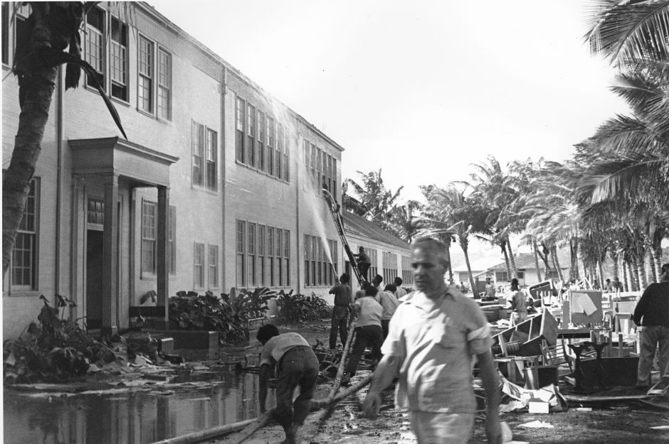 Rescue workers help evacuate the Lunalilo High School in Honolulu after the roof of the main building was hit by a bomb during the Japanese attack at Pearl Harbor, Hawaii on Dec. 7, 1941. (AP Photo)