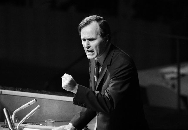"FILE - In this Oct. 18, 1971, file photo, U.S. Ambassador George H.W. Bush gestures as he addresses the United Nations General Assembly during the China debate. He denied the U.S. formula was either a ""Two Chinas"" or a ""One China and one Taiwan"" plan. Bush died at the age of 94 on Friday, Nov. 30, 2018, about eight months after the death of his wife, Barbara Bush. (AP Photo/File)"