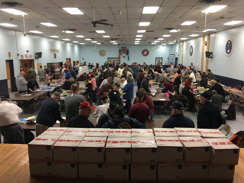 The community gift wrapped over 200 care packages Thanksgiving night at the New Britain VFW organized by a Berlin resident. |Karen Cote, contributed.