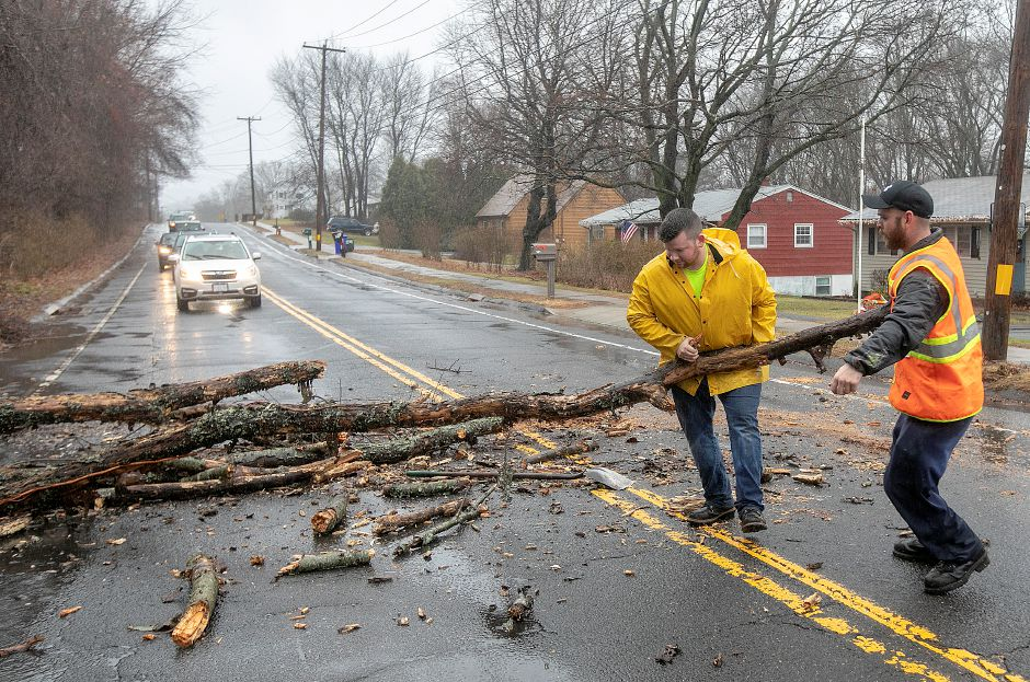City workers William Nichols, left, and John Walker, right, remove fallen limbs on Bee Street in Meriden, Fri., Dec. 21, 2018. Dave Zajac, Record-Journal