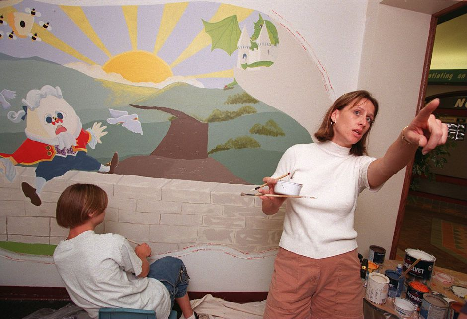 RJ file photo - Traci Walsh DiPietro of Meriden directs children painting a mural at the Wallingford Parks and Recreation Department building Aug. 11, 1998. Beside DiPietro, Ryan Mrozinski of Wallingford works on Humpty Dumpty