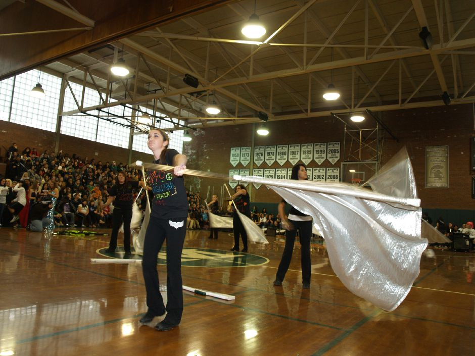 Kim Leahy, a senior, twirls a flag with the Maloney High School Color Guard during a pep rally Wednesday morning, November 23, 2011. (Richie Rathsack / Record-Journal)