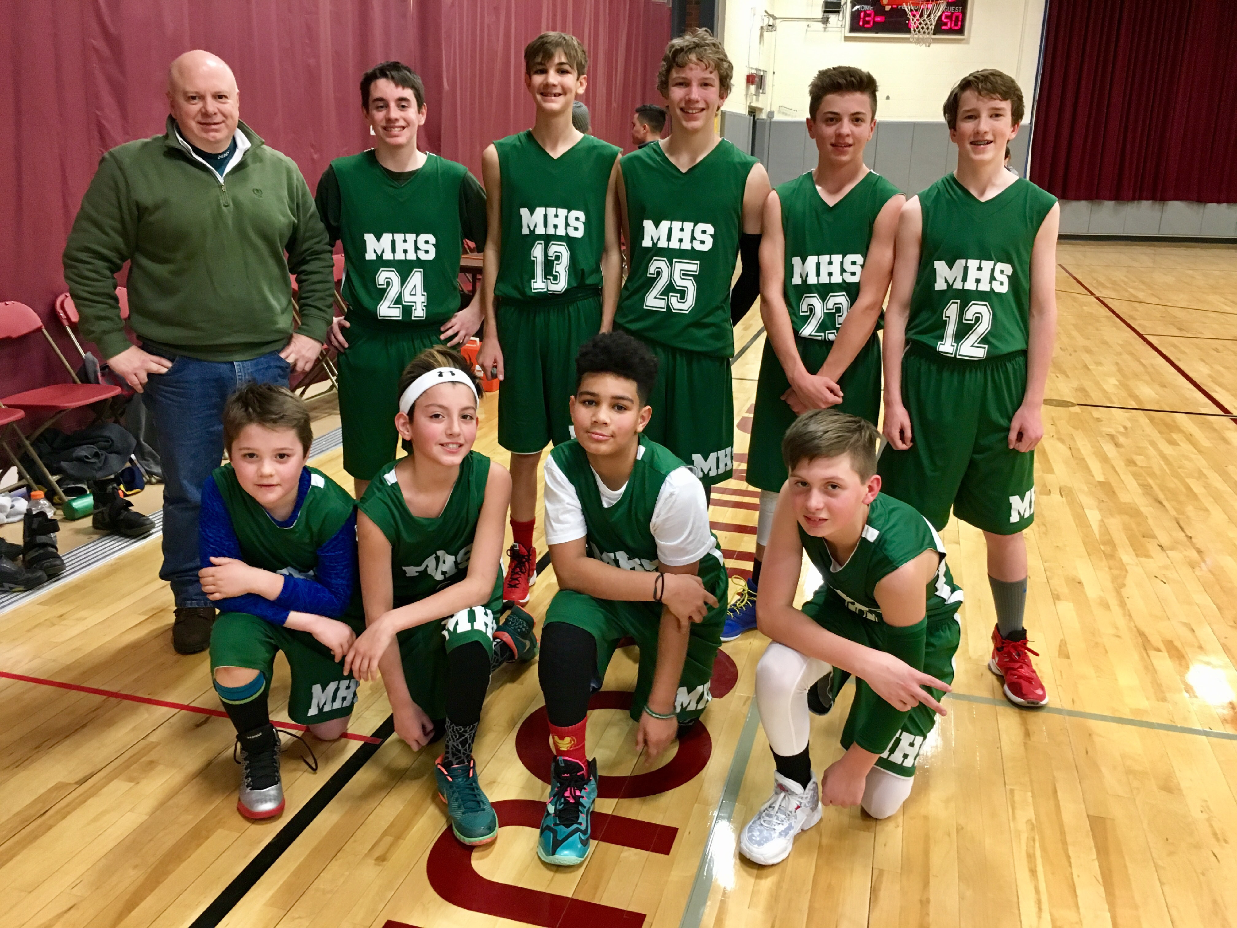 The Mooreland Hill School boys basketball team, front row, from left: Cyrus Revenaugh, Macario Mendoza, Kameron Garcia, and Joseph LeConche. Back row: Coach Bob LeConche, AJ Argazzi, Liam Curley, Josh Cronkhite, Jack Luppino and Jack Carter.