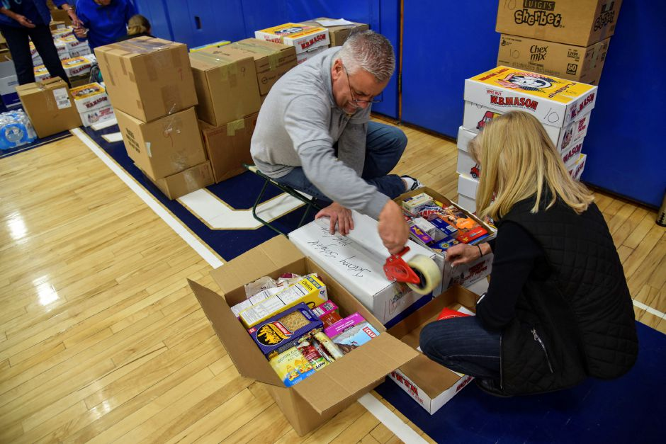 Community members help sort and pack food donations at Coginchaug Regional High School. The goods were collected during the 13th annual Community Round-up in Durham and Middlefield on Saturday, Dec. 1. | Bailey Wright, Town Times