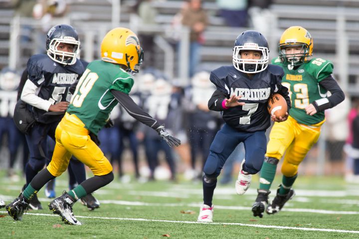 Meriden's Stylz Mitchell breaks out for a touchdown run to put the Raiders on the board Sunday. | Justin Weekes, for the Record-Journal