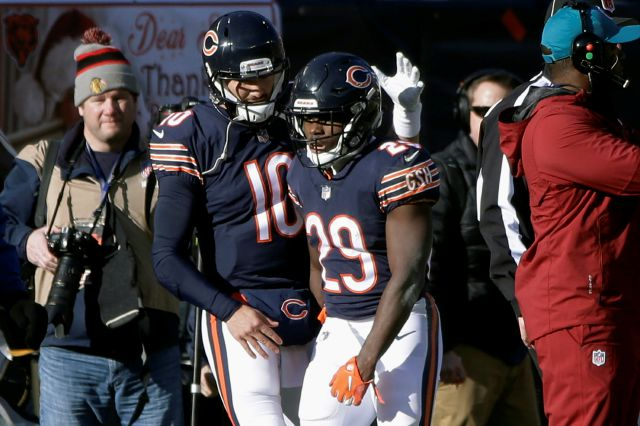 d4d8dae47 ... beat Packers to clinch NFC North title. Chicago Bears quarterback  Mitchell Trubisky (10) and running back Tarik Cohen (29)