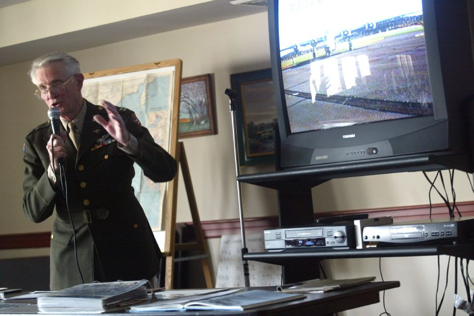 WW II veteran Walt Hushak speaks with residents at The Orchards in Southington about his experience as a captain in the United States Army. Hushak flew B24 Liberators. Including a video, of a B24 Liberator, seen on the video,and photographs, Hushak also displayed a chart of how many Southington residents have served as well as dies in battle since the Revolutionary War.