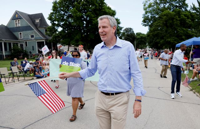 FILE - In this July 4, 2019, file photo, Democratic presidential candidate New York Mayor Bill de Blasio walks in the Independence Fourth of July parade in Independence, Iowa. de Blasio said Friday, Sept. 20 that he is ending his campaign for the Democratic presidential nomination. (AP Photo/Charlie Neibergall, File)