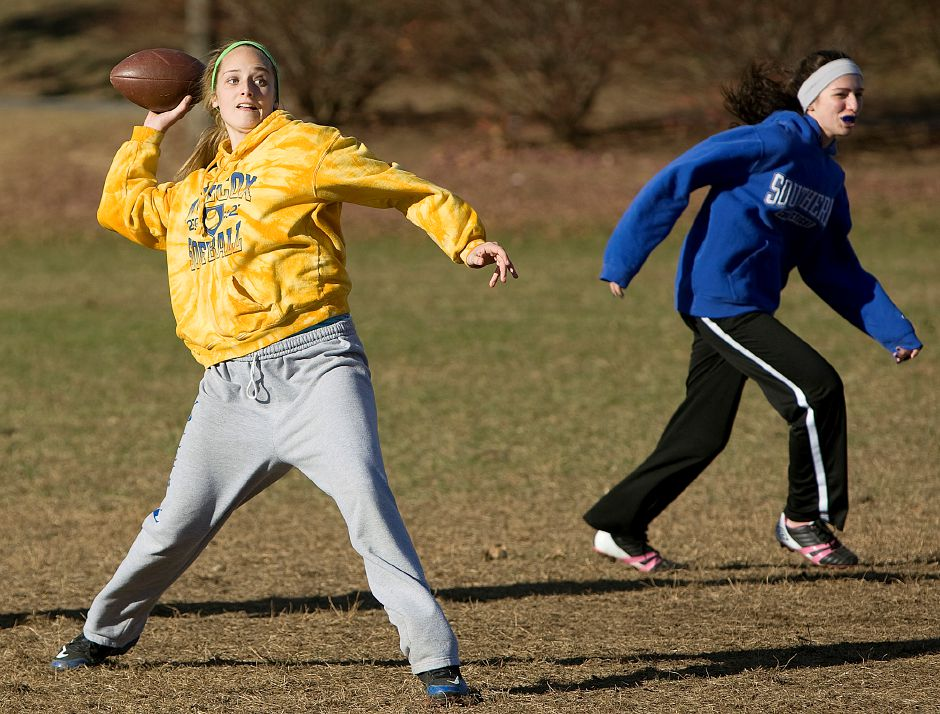 Wilcox Tech quarterback Brianna Fahy, 17, left, gears up for a pass as Jessica Shiels, 17, right, sprints to the outside during Powder Puff football practice at Wilcox Tech in Meriden, Wednesday, November 20, 2013. | Dave Zajac / Record-Journal