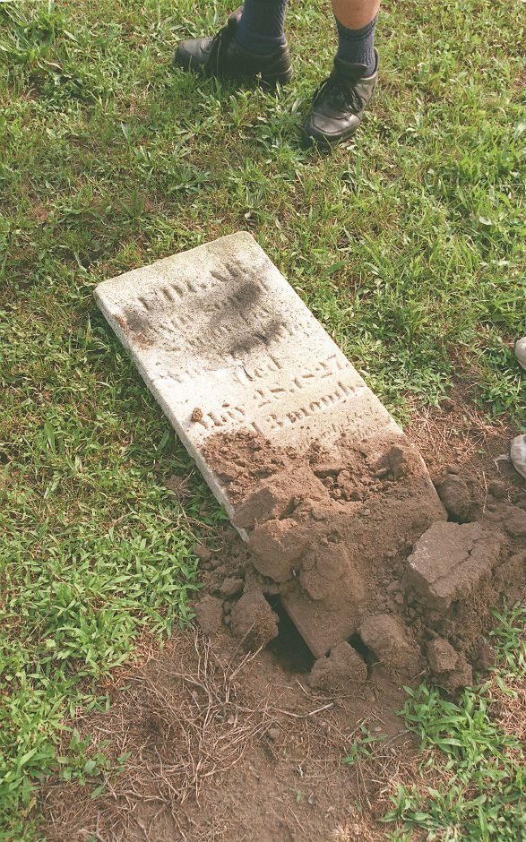 An overturned grave stone in Wallingford