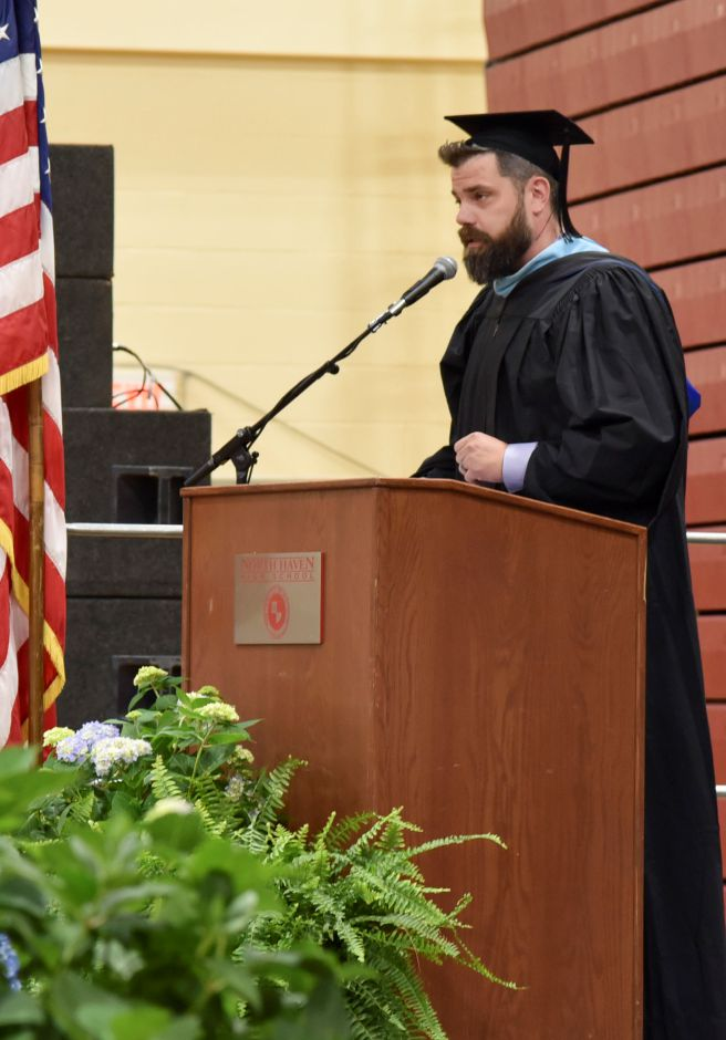 Superintendent of Schools Patrick Stirk addresses graduates during the North Haven High School graduation ceremonies indoors at the school on June 13, 2019. | Bailey Wright, Record-Journal