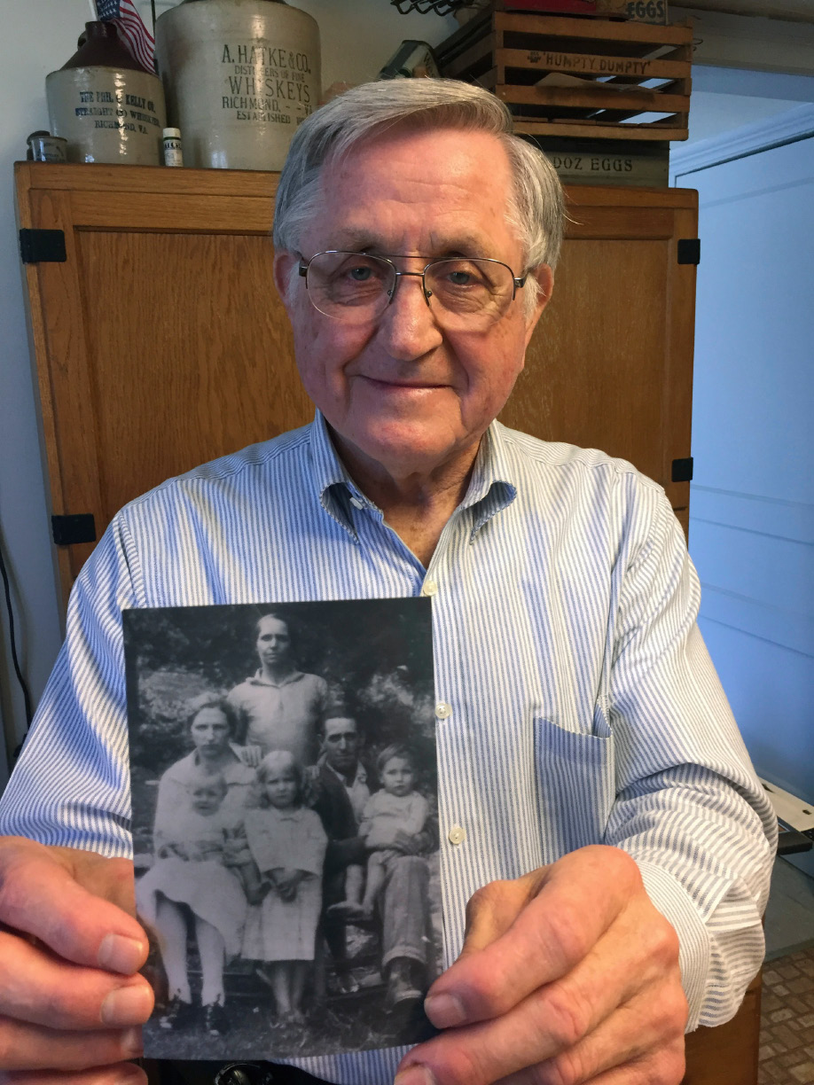 ADVANCE FOR MONDAY MARCH 20 AND THEREAFTER - In a March 12, 2017 photo, Sherman Shifflett, of Louisa County, Va., whose family was displaced from their home in the mountains of Rockingham County by the creation of Shenandoah National Park,  holds a photo of his family when they lived on what is now park land. His family included his mother and father, seated, Nelie and Harvey Shifflett, siblings Ed, on his mother