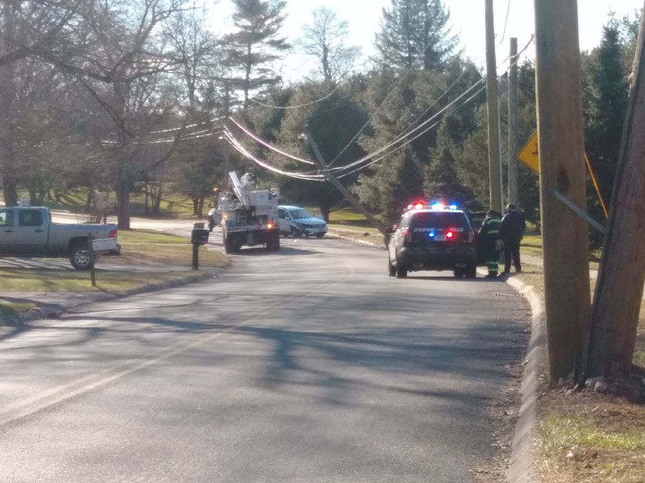 A section of Oak Avenue is closed after a car crashed into a pole. | Jeniece Roman, Record-Journal