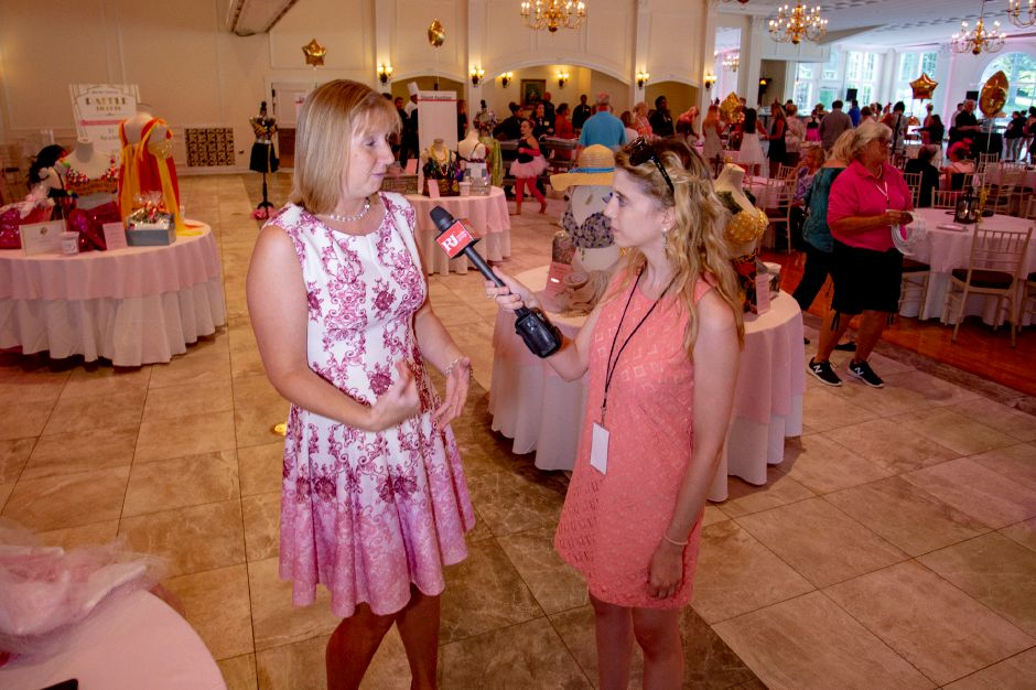 After the Storm Inc. President and Founder Christine Willett talks with Record-Journal Digital Content Producer Ashley Kus as the Art Bra 2018 Runway Show & Auction begins at the Aqua Turf in Southington Aug. 9, 2018. | Richie Rathsack, Record-Journal