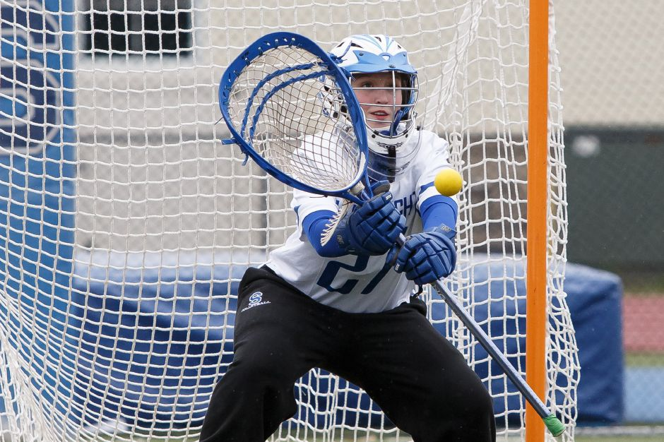 Senior Julia Wells anchors the Southington defense in goal. With a deft touch on clears, Wells also helps jump-start the offense. | Justin Weekes / Special to the Record-Journal