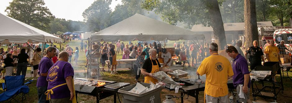 Meriden Lions Club members cook up hamburgers during the 14th annual National Night Out at Hubbard Park in Meriden, Tuesday, August 7, 2018.  Dave Zajac, Record-Journal