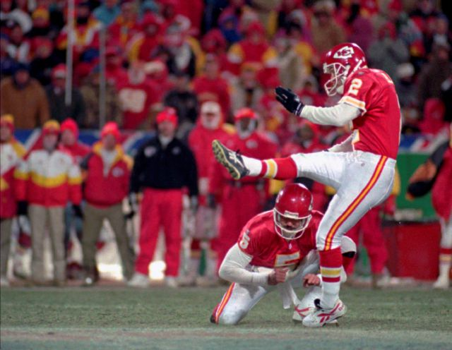 FILE - In this Jan. 7, 1996, file photo, Kansas City Chiefs kicker Lin Elliott attempts a 42-yard field goal that missed wide of the goal and would have tied the game in the final minutes of the AFC divisional playoff game against the Indianapolis Colts, in Kansas City. The miss gave the Colts a 10-7 victory. Holding on the play it the Chiefs