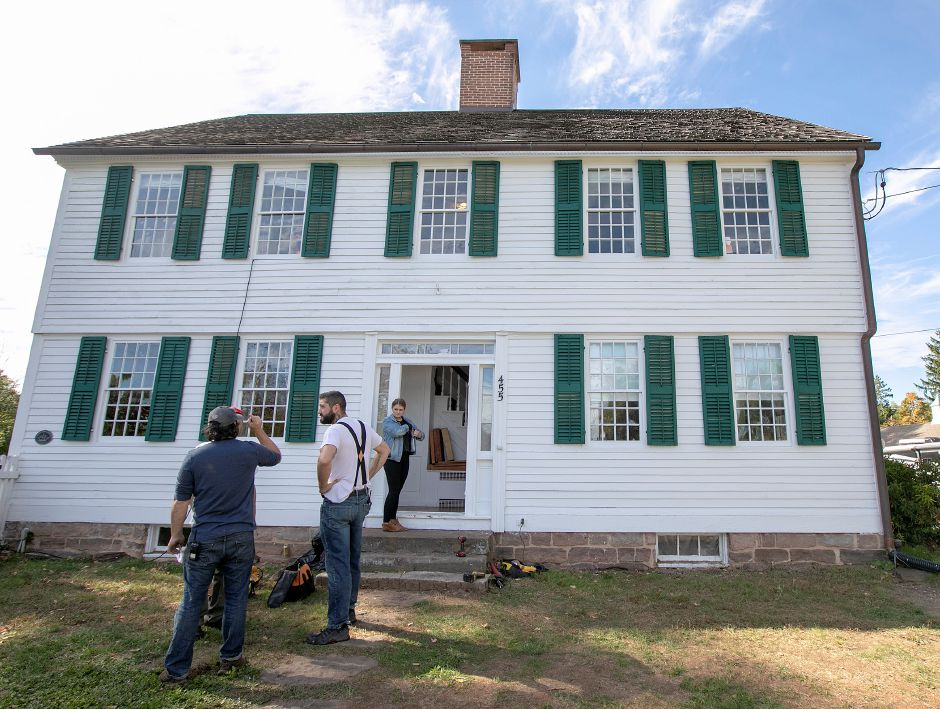 "Film crews work Friday at an 18th century house at 455 East Street in Middletown during the filming of ""My Adventures With Santa.""  Dave Zajac, Record-Journal"