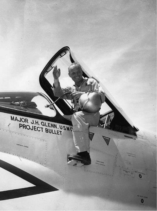 Marine pilot Maj. John H. Glenn Jr. prepares to step down from the F8UI Crusader at Floyd Bennet Field on July 16, 1957 after making the first non-stop supersonic flight from Los Angeles to New York. Glenn landed 3 hours, 23 minutes, 8.4 seconds after departure from Los Alamitos Naval air station in Ca., breaking the previous record set in 1955 by an F84F. (AP Photo/ANTHONY CAMERANO)
