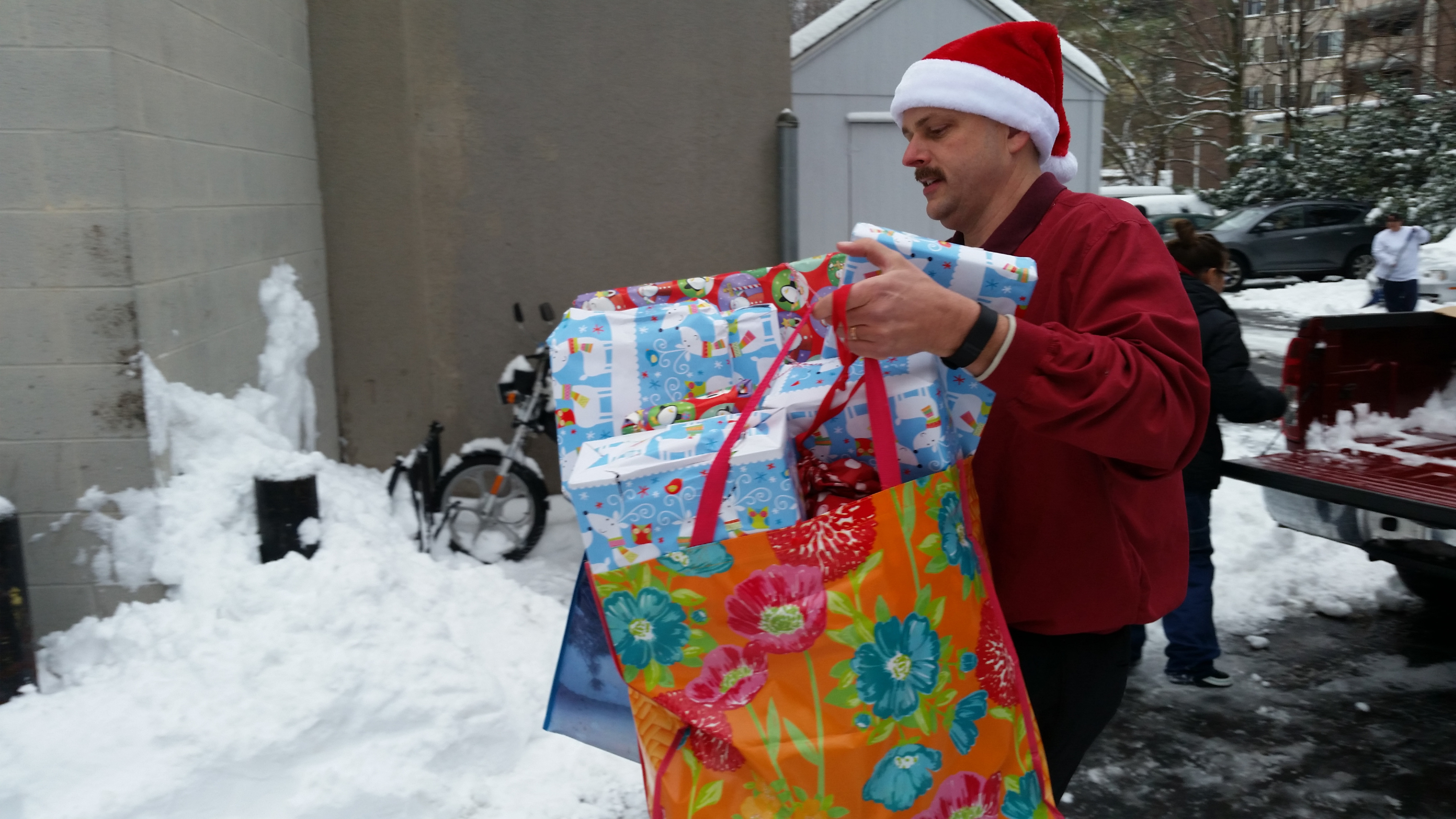 George Hall brings gifts into the shelter on St. Casimir Drive on Saturday. | Lauren SIevert, Record-Journal