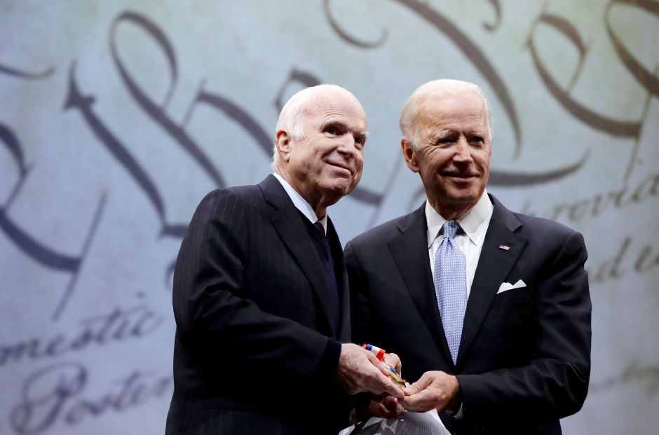 **TRANSMITTED FROM CAMERA** Sen. John McCain, R-Ariz., receives the Liberty Medal from Chair of the National Constitution Center's Board of Trustees, former Vice President Joe Biden, and center President and CEO Jeffrey Rosen in Philadelphia, Monday, Oct. 16, 2017. The honor is given annually to an individual who displays courage and conviction while striving to secure liberty for people worldwide. (AP Photo/Matt Rourke)