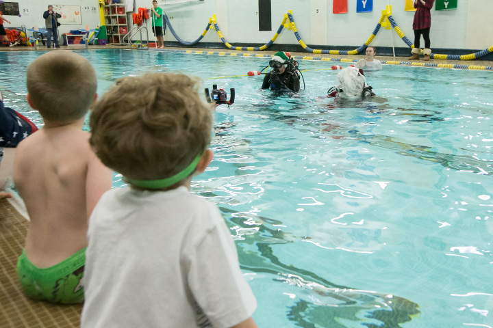 Keagan Bundock-Simjian 7 left and Nathan Clark 7 both of Wallingford watch as Santa surfaces in the pool Sunday during Scuba with Santa at the Wallingford YMCA in Wallingford Dec. 13, 2015 | Justin Weekes / For the Record-Journal