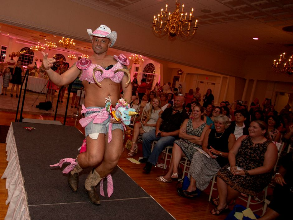 "Brian Hubbs rides down the runway wearing ""Nice Rack"" during the Art Bra 2018 Runway Show and Auction Aug. 9, 2018 at the Aqua Turf in Southington. 